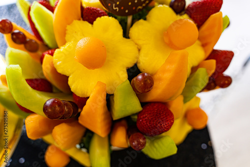Edible Fruit basket arrangement with a variety of fruits Fototapet