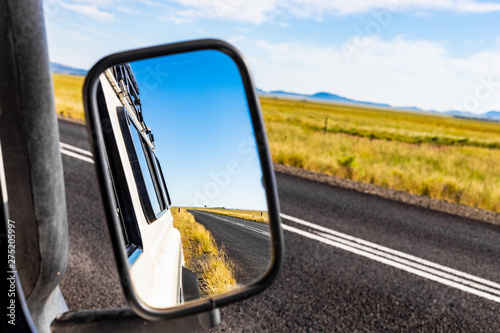 Photo  Rear view in a side Mirror of 4x4 vehicle