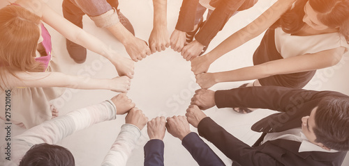 Carta da parati Creative team meeting hands synergy brainstorm business man woman in circle top view on white background