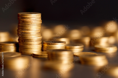 Cuadros en Lienzo  Stack of Gold Coin on Black Background.