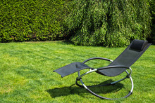 Rocking Lounger On A Green Grass. Summer Time. Copy Space