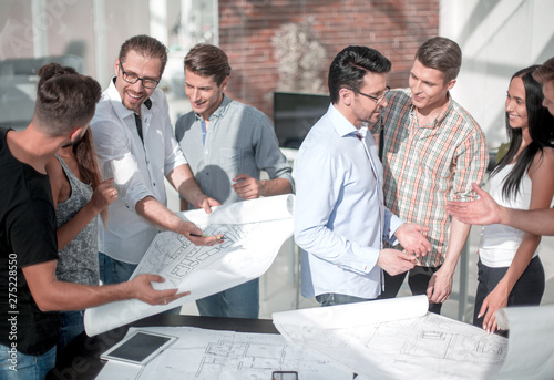 Fototapety, obrazy: group of designers and architects discussing new sketches