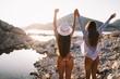 Leinwandbild Motiv Group of beautiful young women friends walking on the beach