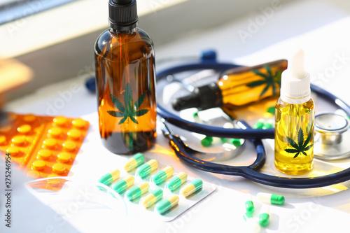 Marijuana oil medicinal pills with stethoscope Wallpaper Mural