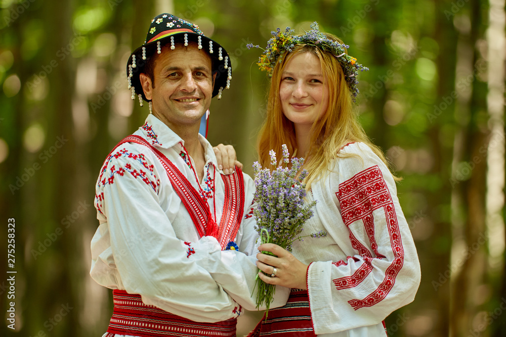 Fototapeta Man and woman in traditional costumes
