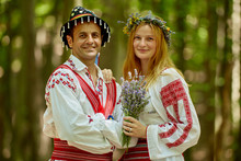 Man And Woman In Traditional Costumes