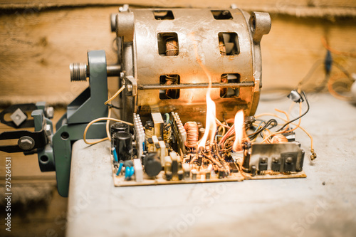 Fototapeta Overloaded electrical circuit causing electrical short and fire