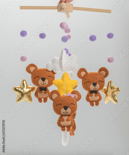 Colorful and eco-friendly children's mobile from felt. On gray background.