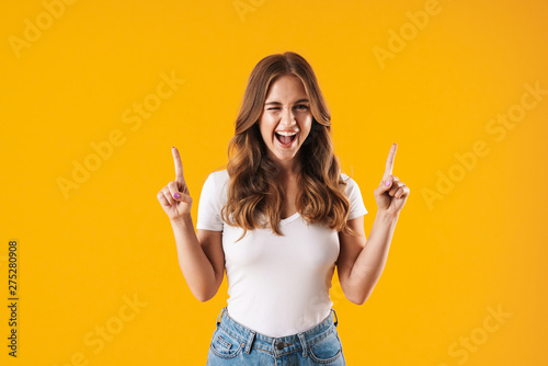 Obraz Excited young girl wearing casual clothes standing - fototapety do salonu