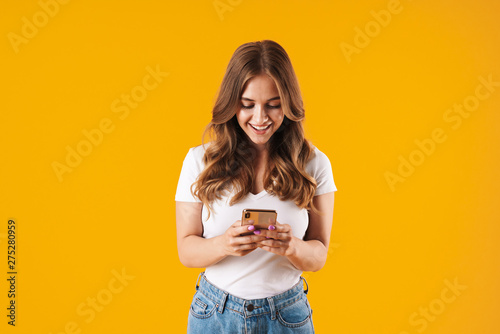 Fotografía  Excited young girl wearing casual clothes standing