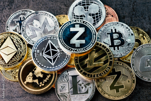 Fototapeta Crypto currency background with various of shiny silver and golden physical cryptocurrencies symbol coins, Bitcoin, Ethereum, Litecoin, zcash, ripple obraz