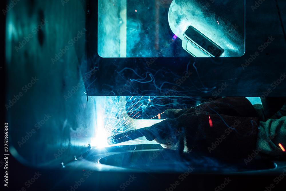 Fototapety, obrazy: Welder working in factory