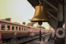 Gold Train Station Bell Local In Thailand With Vintage Train Background.shallow Focus Effect.vintage Tone.