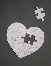 White Heart Shaped Puzzle With Missing Part.