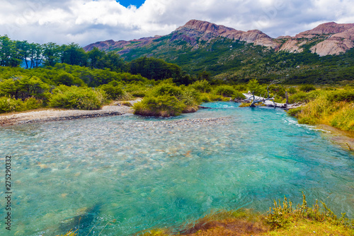 Turquoise river under the Andes mountains