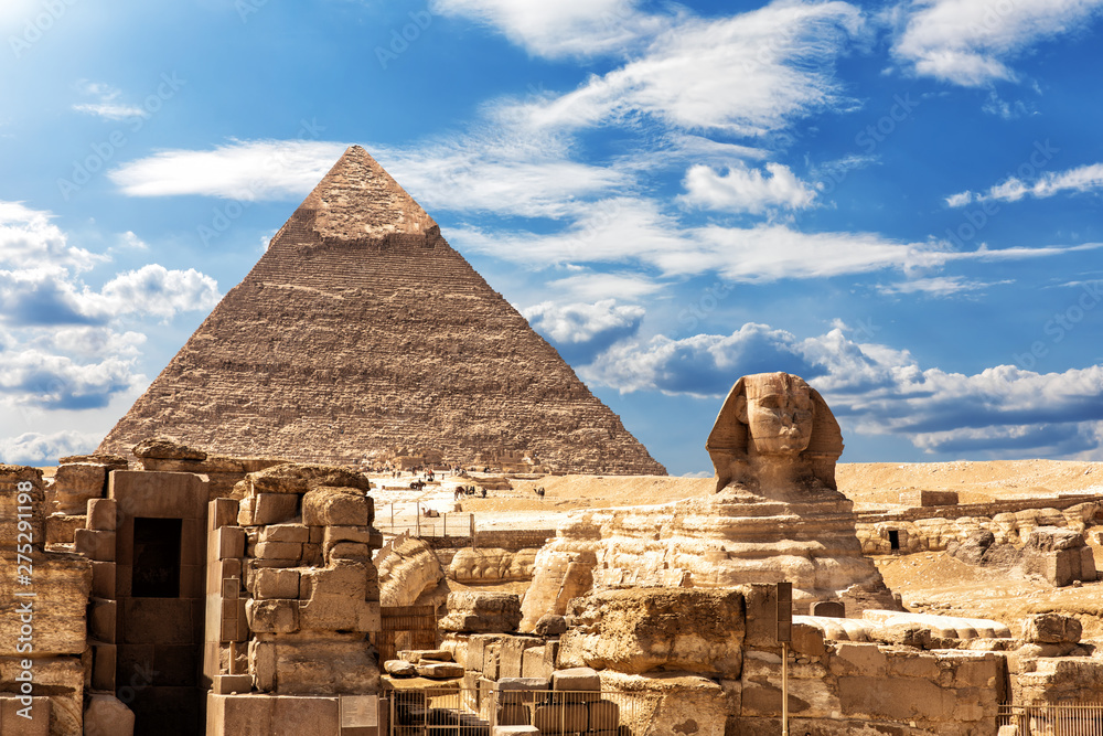 Fototapety, obrazy: The Sphinx, the Temple and the Pyramid of Chephren under the clouds in Giza