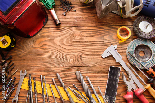 Fotomural  tools male workplace background texture dark wood