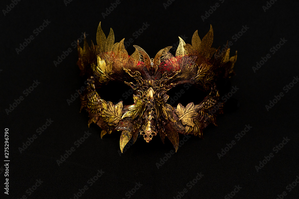 Fototapety, obrazy: Venetian mask in gold and red with metallic pieces in the form of leaves. original and unique design, handmade crafts