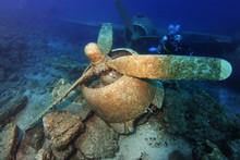 Scuba Diver Search Plane Crash Site Motor Unit In Dramatic Light