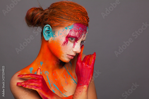 Portrait of a model in an expressive creative style using an unusual make-up Canvas Print