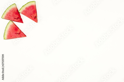 Fototapety, obrazy: Triangular isolated slices of watermelon forming geometric games for copy space on a white background