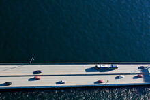 View Of Cars Driving Over Floating Bridge