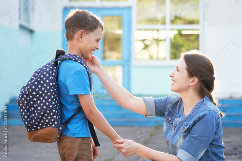 mother accompanies the child to school  mom encourages