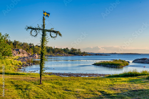 фотография Sunrise of a classic midsommer pole at the coast line of Roslagen