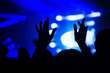 canvas print picture - Silhouettes of concert crowd in front of bright stage lights. Nightlife and concert party concept.