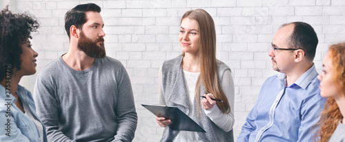 Psychiatrist talking to addicted patients at group session Wallpaper Mural