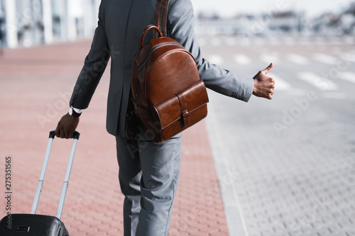 Business Executive Calling Cab At the Airport