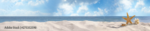 Montage in der Fensternische Strand Set of different stylish beach accessories on sand. Space for text
