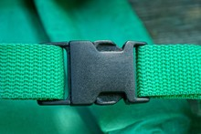 One Black Carbine Latch On The Harness On The Green Matter Of The Backpack