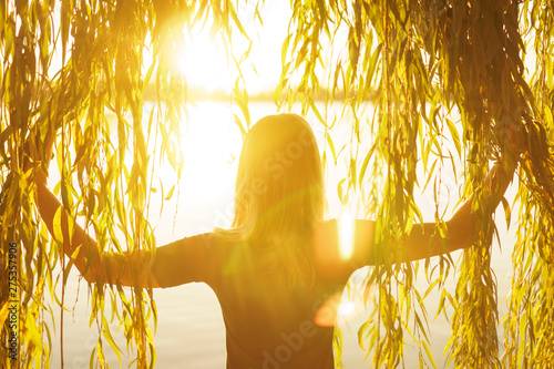 Fotografie, Tablou Autumn portrait of young girl with willow branches on the background of a lake a