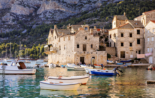Wallpaper Mural Sea village life in the town of Vis in Croatia with boats in the harbor