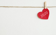 2020 New Year Greeting Card Template, Red Fabric Heart With 2020 Word Hanging On White Wall Background With Copy Space