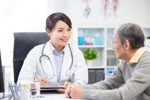 Female doctor see elder patient Canvas Print