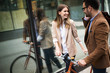Attractive young business couple embracing at street