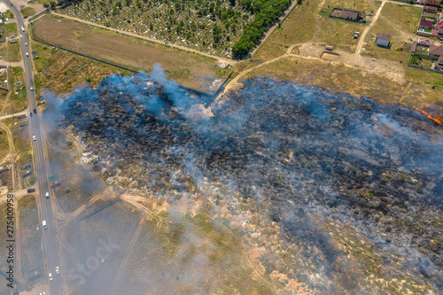 Foto op Plexiglas Oceanië Heavy smoke in steppe. Forest and steppe fires destroy field, steppes during severe droughts. Fire, strong smoke. Blur focus due to shaking hot fire. Disaster, damage, risk to homes. View from drone
