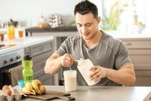 Sporty Man Making Protein Shak...