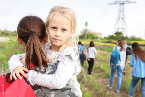 Fotografie, Obraz  Mother with little daughter among group of illegal migrants escaping from their