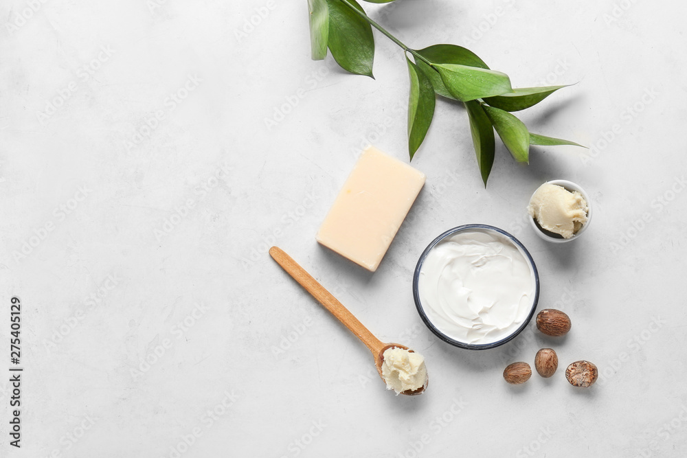 Fototapety, obrazy: Shea butter with cream and soap on light background