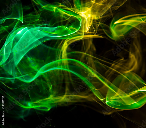 Tuinposter Fractal waves Colored smoke on black background