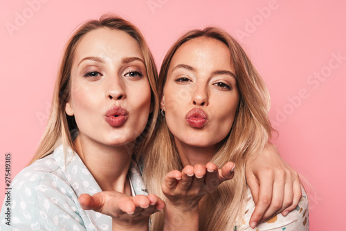 Two attractive blonde girls wearing summer outfit Tablou Canvas