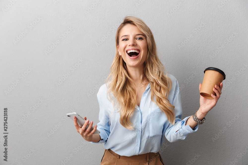 Fototapeta Attractive young blonde businesswoman wearing shirt
