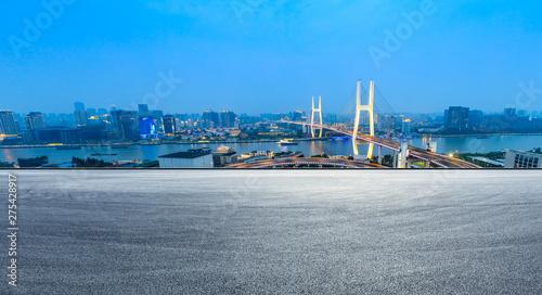Empty road and Nanpu bridge at night in Shanghai,China Wallpaper Mural