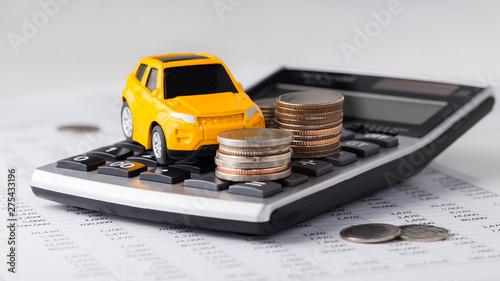 Fotografia  Car and coins on calculator