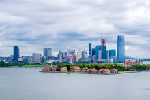 USA, New York, Ellis Island And Jersey City's Skyline Seen From The Upper Bay