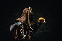 Portrait Of A Shaman Holding A Human Skull