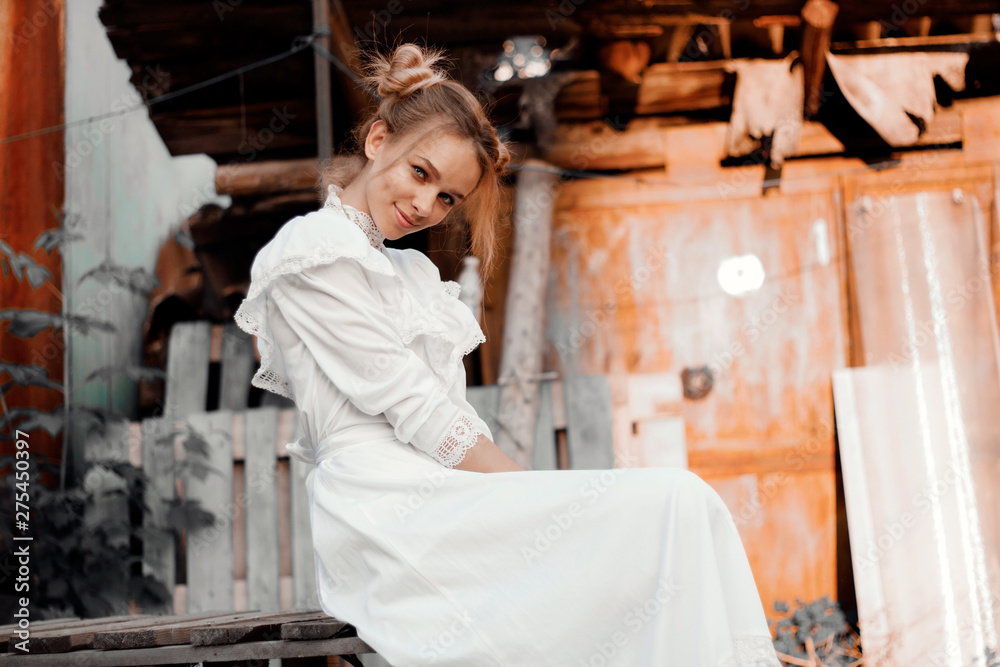 Fototapety, obrazy: young girl in retro style in white dress sitting smiling emotion of joy in the village
